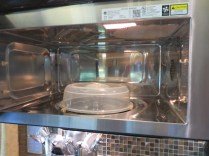 "Microwave emptied of ""rattling rack"""